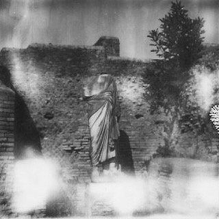 #figure at #ostiaantica #italia #italy on tour w/ #spaldingmfa early July #hotasblazes there #makerealphotos #makerealpictures #analog #bxw #polaroid #impossibleproject #sx70 #film