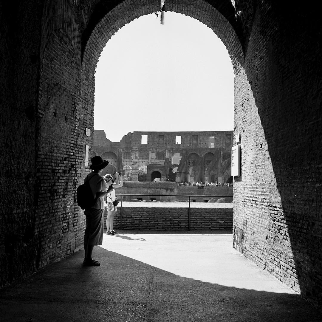 Hiding from the #summerheat in the #roman #colosseum #coliseo #rome #italy #italia this July with #spaldingmfa summer residency #Roma #blackandwhite #shootfilm #120film #hasselblad #silhouette looks like #audreyhepburn #romanholiday #streetphotography